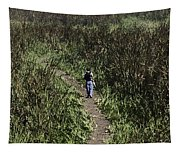 Man Walking Through Tall Grass In The Okhla Bird Sanctuary Tapestry