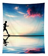 Silhouette Of Man Running At Sunset Tapestry by Michal Bednarek