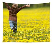 Young Boy Running Through Field Of Tapestry