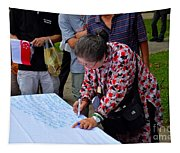 A Lady Signs Petition At May Day Rally Singapore Tapestry