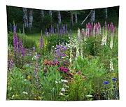 A Mixture Of Flowers Bloom In Hillside Tapestry