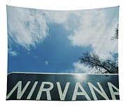 A Sign That Reads Nirvana Tapestry