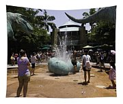 A Water Fountain With Dinosaur Eggs In Universal Studios Singapore Tapestry