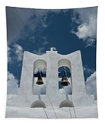 A Whitewashed Bell Tower And Dramatic Tapestry