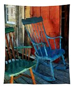 Blue Chair Against Red Door Tapestry