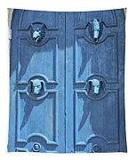 Blue Door Decorated With Wooden Animal Heads Tapestry