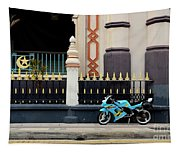 Blue Yellow Sporty Motorcycle Parked On Pavement Tapestry