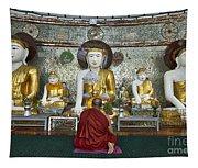faithful Buddhist monk praying at Buddha Statues in SHWEDAGON PAGODA Tapestry