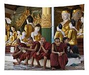 faithful Buddhist monks siiting around Buddha Statues in SHWEDAGON PAGODA Tapestry