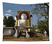 four sitting Buddhas 30 metres high looking in four points of the compass at Kyaikpun Pagoda Tapestry