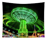 Illuminated Fair Ride With Blurred Neon Tapestry