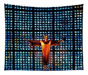 Jesus Sculpture And Blue Glass Background Tapestry
