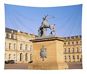 Low Angle View Of Statues In Front Of A Tapestry