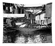 Man Plying A Small Boat Laden With Vegetables In The Dal Lake Tapestry