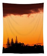 Orange Sunset And Silhouettes Of Norfolk Pines Tapestry