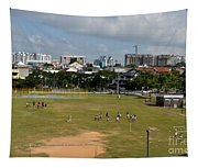 Schoolchildren Practicing On Playing Field With Singapore Skyline In Background Tapestry