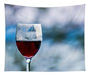 Single Glass Of Red Wine On Blue And White Background Tapestry