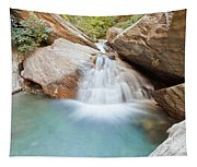 Small Waterfall Casdcading Over Rocks In Blue Pond Tapestry