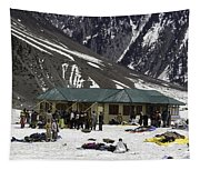 Tourists Surrounded By Snow And Ice Outside One Of The Few Buildings Tapestry