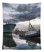 Tugboat Pulling A Cargo Ship Tapestry by Olivier Le Queinec