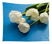Tulip Flowers Over Blue Tapestry
