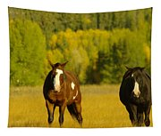 Two Horses Walking Along Tapestry