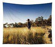 Woman Running Through Field Tapestry