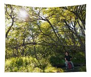 Woman Sitting On Bench - Bright Green Trees Sun Is Shining Tapestry