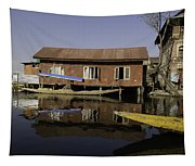 Yellow Shikara In Front Of A Run Down Area Of Houses In The Dal Lake Tapestry