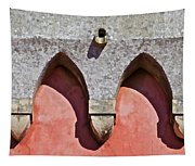 Ornate Design Of Carved Stone Arch Against A Red Faded Plaster Wall Tapestry