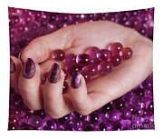 Woman Hand With Purple Nail Polish On Candy Tapestry