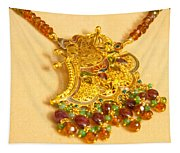 A Beautiful Intricately Carved Gold Pendant Hanging From A Semi-precious Stone Chain Tapestry