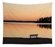 A Bench Silhouetted At Sunset Near The Tapestry