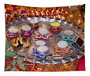 A Decorated Hindu Prayer Thaali With Wax Candles Oil Lamps Tapestry
