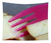 A Plastic Fork Being Used To Cut Into A Piece Of Cut Apple Pieces Tapestry