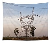 A Transmission Tower Carrying Electric Lines In The Countryside Tapestry