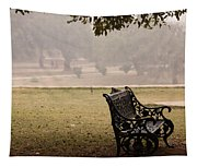 A Wrought Iron Black Metal Bench Under A Tree In The Qutub Minar Compound Tapestry