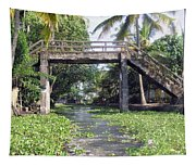 An Old Stone Bridge Over A Canal In Alleppey Tapestry