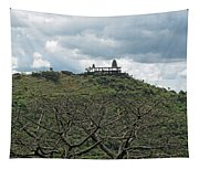 An Old Temple Building On Top Of A Hill With A Lot Of Clouds In The Sky Tapestry