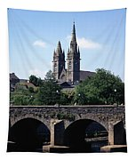 Arch Bridge Across A River With A Tapestry