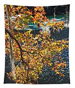 Colorful Fall Leaves Over Blue Water Tapestry