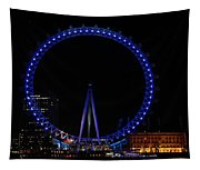 London Eye All Done Up In Blue Light In The Night With A Small Reflection In The Thames Tapestry