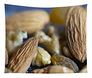 Macro Shots Of Various Dry Fruit Items Such As Almonds And Walnuts And Raisins Tapestry