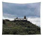 The Structure Of An Abandoned Temple On The Top Of A Green Covered Hill With Blue And White Clouds I Tapestry