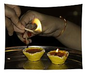 Trying To Light An Oil Lamp That Has Gone Out Tapestry