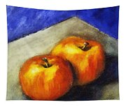 Two Apples With Blue Tapestry