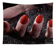 Woman Hand With Red Nail Polish Buried In Black Sand Tapestry
