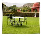 Wrought Metal Chairs Around A Table In A Lawn Tapestry