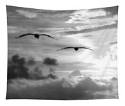 2 Pelicans Flying Into The Clouds Tapestry