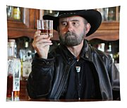 A Bearded Cowboy In Black Contemplates His Whiskey In A Saloon Tapestry